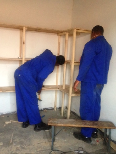 Building of the book shelves to help the school children in Victoria Falls,Zimbabwe