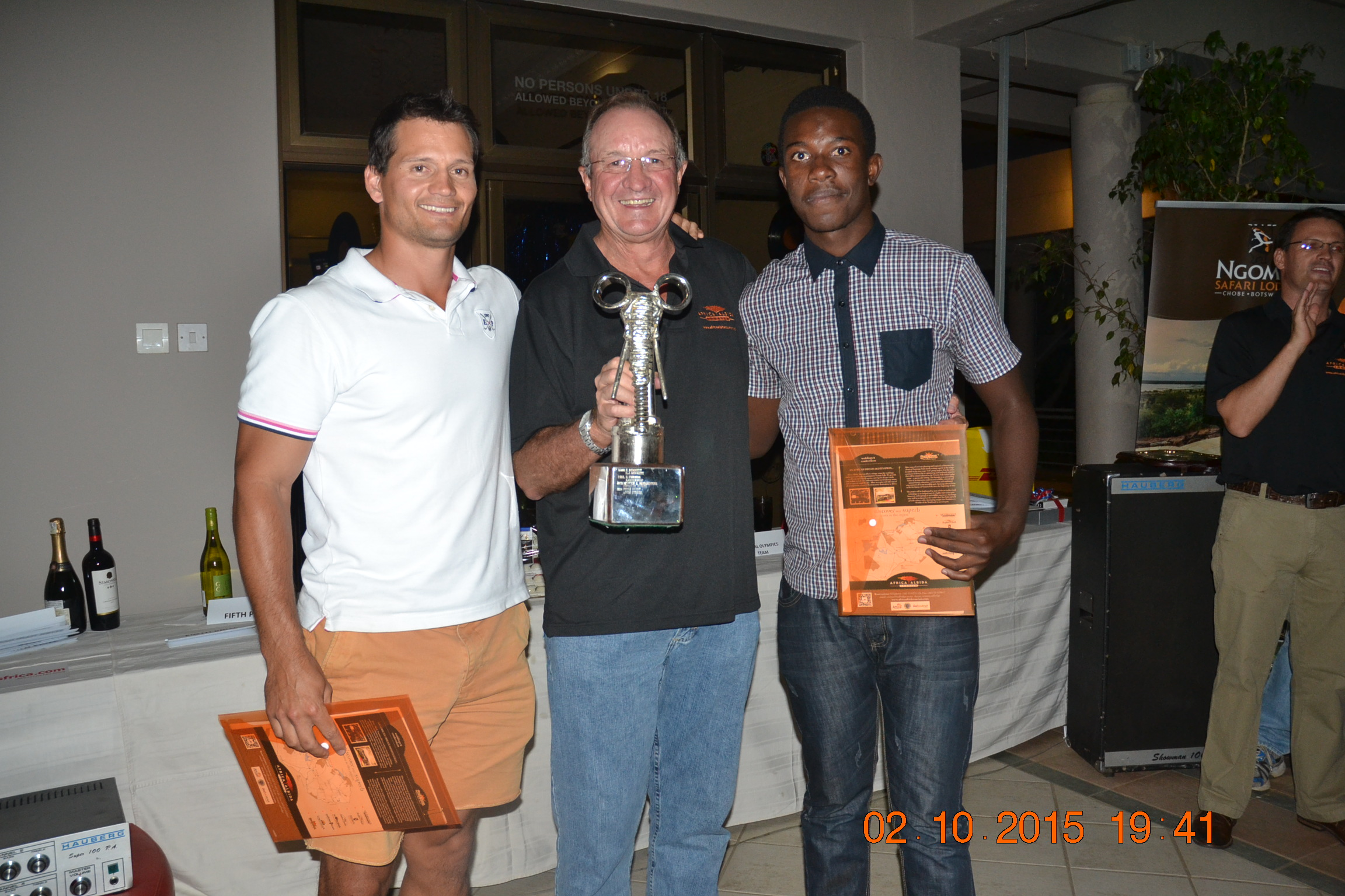 Winners Blair Tabera (Left) and Munya Mudyanadzo (right) being presented with the Trophy by AAT Group Chairman Dave Glynn