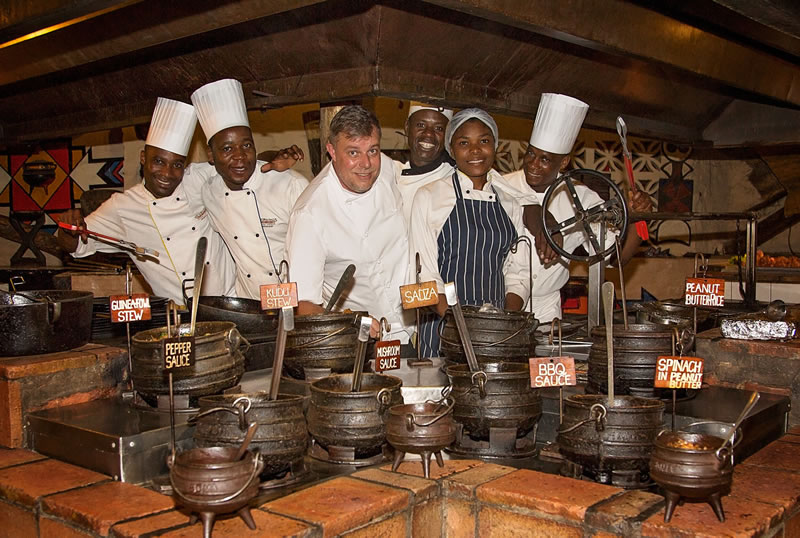 Chef Arnold Tanzer with the culinary team at The Boma - Dinner & Drum Show, Victoria Falls, Zimbabwe
